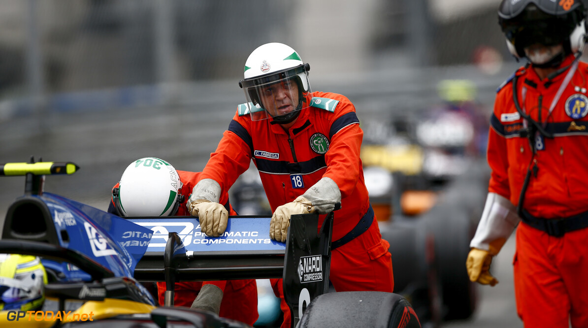FIA Formula 2 MONTE CARLO, MONACO - MAY 24: Marshal pushing Luca Ghiotto (ITA, UNI VIRTUOSI) during the Monaco at Monte Carlo on May 24, 2019 in Monte Carlo, Monaco. (Photo by Andy Hone / LAT Images / FIA F2 Championship) FIA Formula 2 Andy Hone  Monaco  portrait