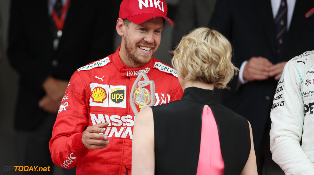 Formula One World Championship 2nd place Sebastian Vettel (GER) Ferrari SF90 with Princess Charlene of Monaco. 26.05.2019. Formula 1 World Championship, Rd 6, Monaco Grand Prix, Monte Carlo, Monaco, Race Day. - www.xpbimages.com, EMail: requests@xpbimages.com - copy of publication required for printed pictures. Every used picture is fee-liable. (C) Copyright: Batchelor / XPB Images Motor Racing - Formula One World Championship - Monaco Grand Prix - Sunday - Monte Carlo, Monaco XPB Images Monaco Monte Carlo  Formel1 Formel F1 Formula 1 Formula1 GP Grand Prix one May Monaco Monte Carlo Monte-Carlo Sunday 26 5 05 2019 Podium Portrait