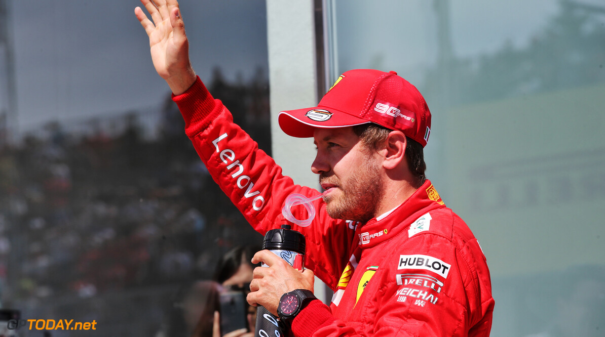 Vettel 'happy' for Ferrari after tough run