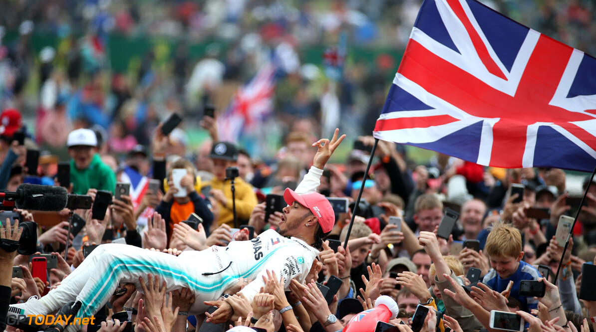Formula One World Championship 1st place Lewis Hamilton (GBR) Mercedes AMG F1 W10 crowd surfing. 14.07.2019. Formula 1 World Championship, Rd 10, British Grand Prix, Silverstone, England, Race Day. - www.xpbimages.com, EMail: requests@xpbimages.com - copy of publication required for printed pictures. Every used picture is fee-liable. (C) Copyright: Batchelor / XPB Images Motor Racing - Formula One World Championship - British Grand Prix - Race Day - Silverstone, England XPB Images Silverstone England  Formel1 Formel F1 Formula 1 Formula1 GP Grand Prix one Circuit Silverstone England Britain British United Kingdom UK Sunday 14 07 7 2019 Podium Portrait