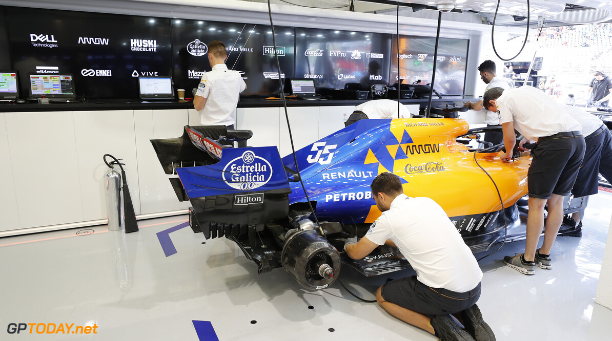 Mechanics work on the Carlos Sainz McLaren MCL34 in the garage  Steven Tee