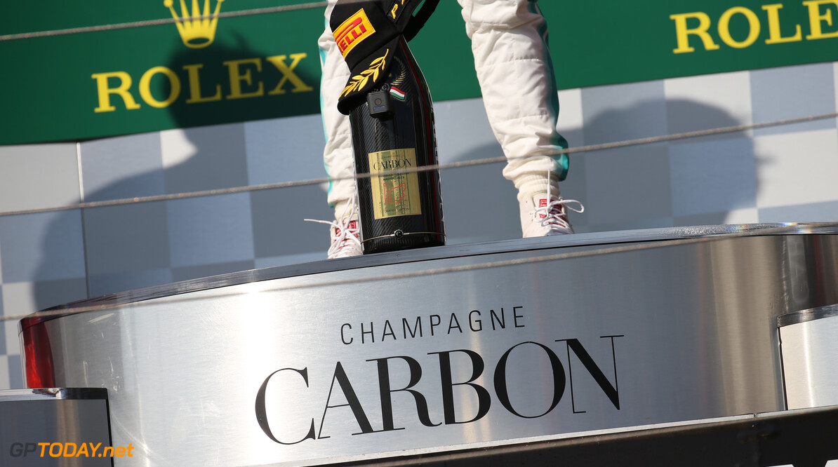 Formula One World Championship Carbon Champagne. 04.08.2019. Formula 1 World Championship, Rd 12, Hungarian Grand Prix, Budapest, Hungary, Race Day. - www.xpbimages.com, EMail: requests@xpbimages.com - copy of publication required for printed pictures. Every used picture is fee-liable. (C) Copyright: Batchelor / XPB Images Motor Racing - Formula One World Championship - Hungarian Grand Prix - Race Day - Budapest, Hungary XPB Images Budapest Hungary  Formel1 Formel F1 Formula 1 Formula1 GP Grand Prix one Circuit Hungary Hungarian Hungaroring Budapest Sunday 04 4 08 8 2019 August Podium Portrait