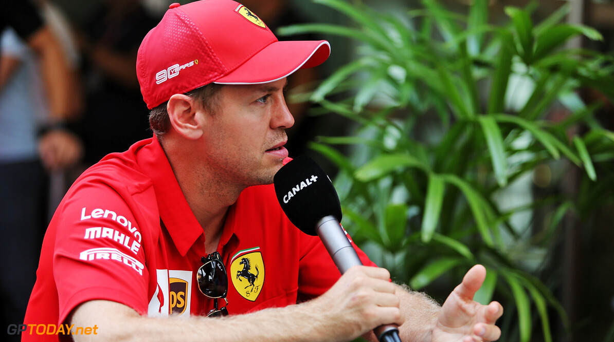 Vettel expecting difficult weekend despite upgrades