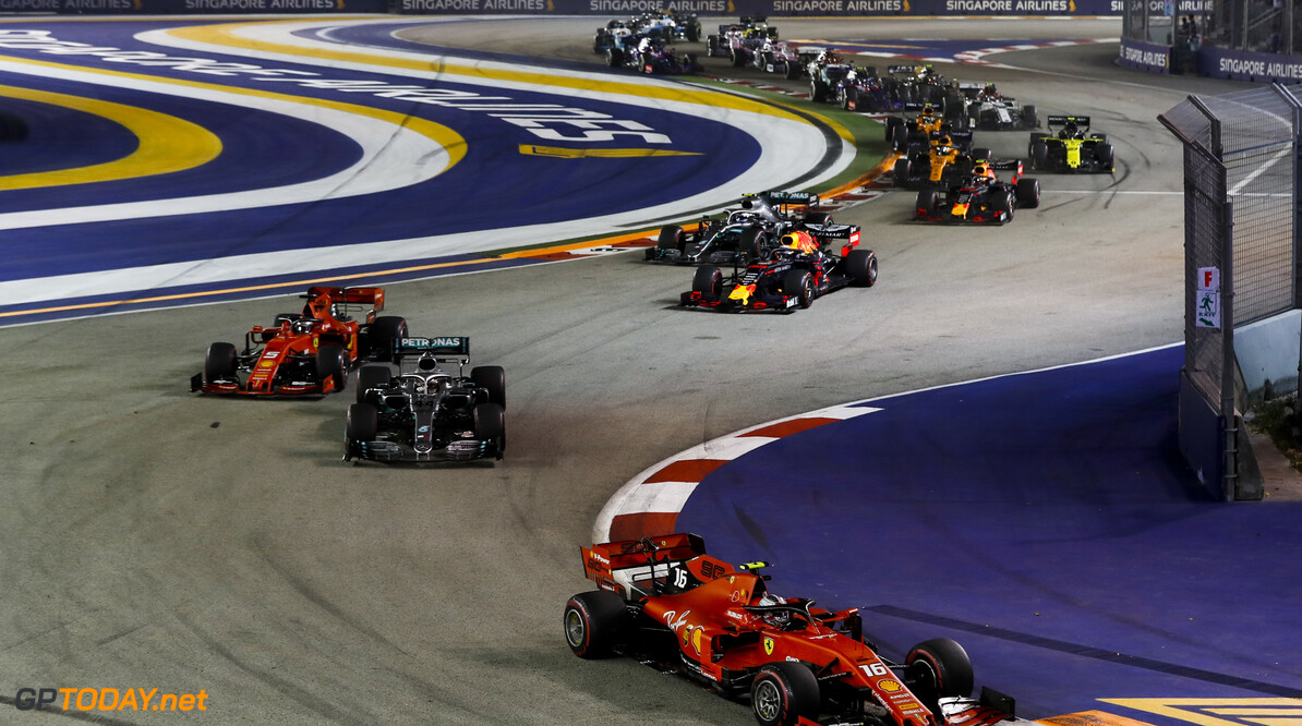 2019 Singapore GP SINGAPORE STREET CIRCUIT, SINGAPORE - SEPTEMBER 22: Charles Leclerc, Ferrari SF90 leads Lewis Hamilton, Mercedes AMG F1 W10, Sebastian Vettel, Ferrari SF90,aa and Valtteri Bottas, Mercedes AMG W10 at the start of the race during the Singapore GP at Singapore Street Circuit on September 22, 2019 in Singapore Street Circuit, Singapore. (Photo by Glenn Dunbar / Motorsport Images) 2019 Singapore GP Glenn Dunbar  Singapore  action ts-live