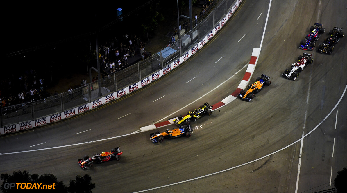 2019 Singapore GP SINGAPORE STREET CIRCUIT, SINGAPORE - SEPTEMBER 22: Carlos Sainz Jr., McLaren MCL34 and Nico Hulkenberg, Renault R.S. 19 make contact during the Singapore GP at Singapore Street Circuit on September 22, 2019 in Singapore Street Circuit, Singapore. (Photo by Simon Galloway / Motorsport Images) 2019 Singapore GP Simon Galloway  Singapore  action sparks ts-live