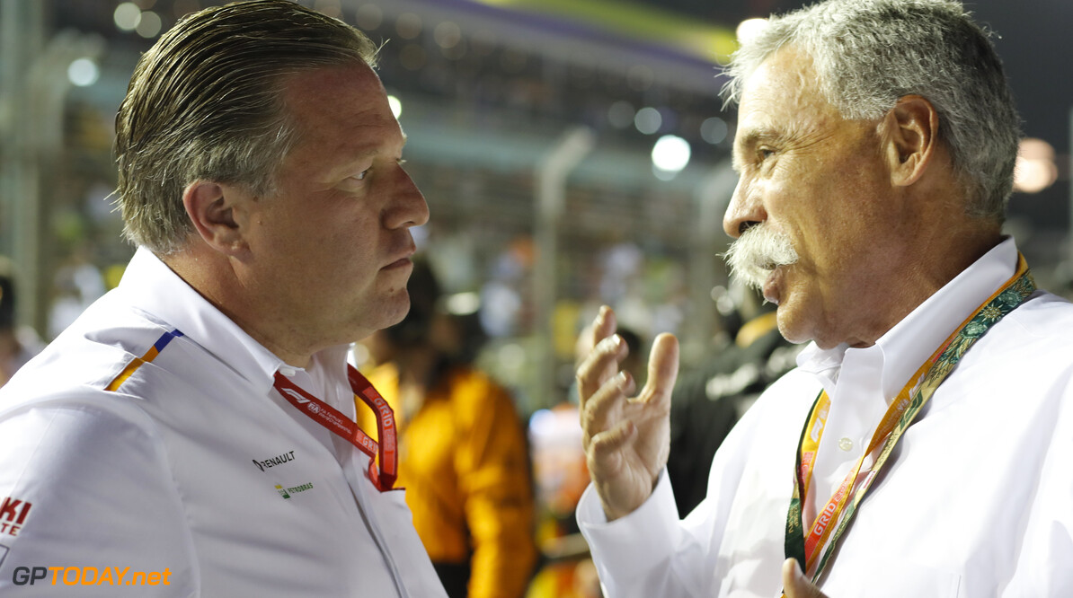 2019 Singapore GP SINGAPORE STREET CIRCUIT, SINGAPORE - SEPTEMBER 22: Zak Brown, Executive Director, McLaren, talks with Chase Carey, Chairman, Formula 1 during the Singapore GP at Singapore Street Circuit on September 22, 2019 in Singapore Street Circuit, Singapore. (Photo by Steven Tee / Motorsport Images) 2019 Singapore GP Steven Tee  Singapore  Portrait