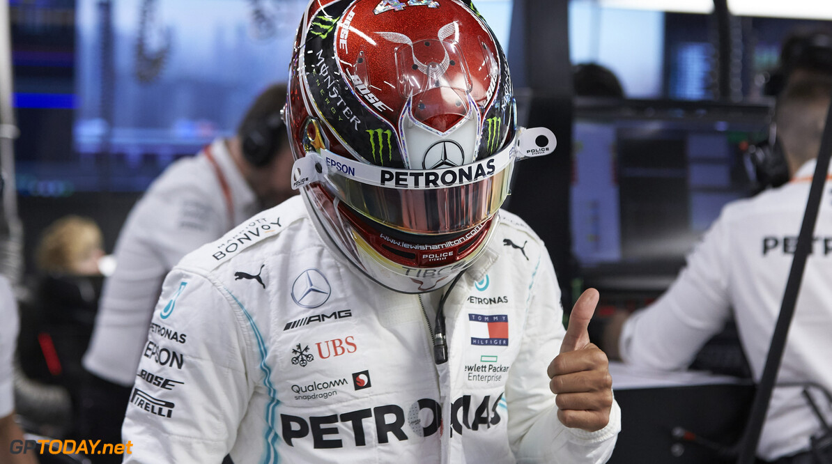 2019 Singapore GP SINGAPORE STREET CIRCUIT, SINGAPORE - SEPTEMBER 21: Lewis Hamilton, Mercedes AMG F1, gives a thumbs up in the garage during the Singapore GP at Singapore Street Circuit on September 21, 2019 in Singapore Street Circuit, Singapore. (Photo by Motorsport Images) 2019 Singapore GP Steve Eherington  Singapore  Portrait Helmets