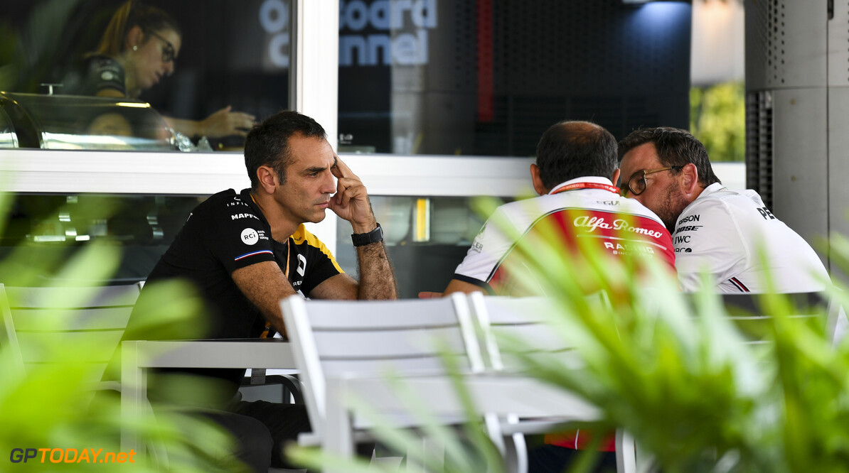 2019 Singapore GP SINGAPORE STREET CIRCUIT, SINGAPORE - SEPTEMBER 19: Cyril Abiteboul, Managing Director, Renault F1 Team and Frederic Vasseur, Team Principal, Alfa Romeo Racing during the Singapore GP at Singapore Street Circuit on September 19, 2019 in Singapore Street Circuit, Singapore. (Photo by Mark Sutton / Motorsport Images) 2019 Singapore GP Mark Sutton  Singapore  Portrait