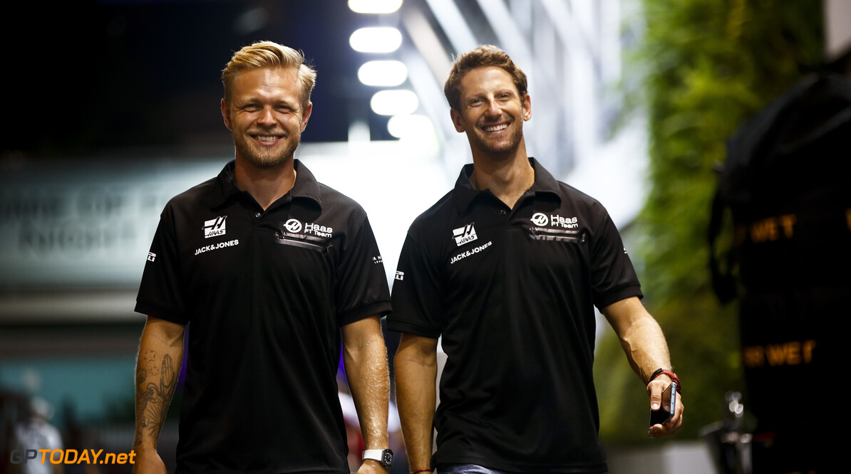 2019 Singapore GP SINGAPORE STREET CIRCUIT, SINGAPORE - SEPTEMBER 19: Kevin Magnussen, Haas F1 and Romain Grosjean, Haas F1 during the Singapore GP at Singapore Street Circuit on September 19, 2019 in Singapore Street Circuit, Singapore. (Photo by Andy Hone / Motorsport Images) 2019 Singapore GP Andy Hone  Singapore  Portrait