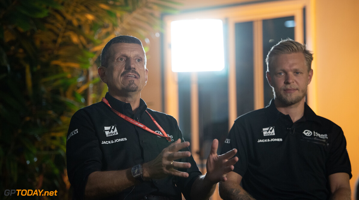 2019 Singapore GP SINGAPORE STREET CIRCUIT, SINGAPORE - SEPTEMBER 19: Guenther Steiner, Team Principal, Haas F1 and Kevin Magnussen, Haas F1 during the Singapore GP at Singapore Street Circuit on September 19, 2019 in Singapore Street Circuit, Singapore. (Photo by Simon Galloway / Motorsport Images) 2019 Singapore GP Simon Galloway  Singapore  Portrait