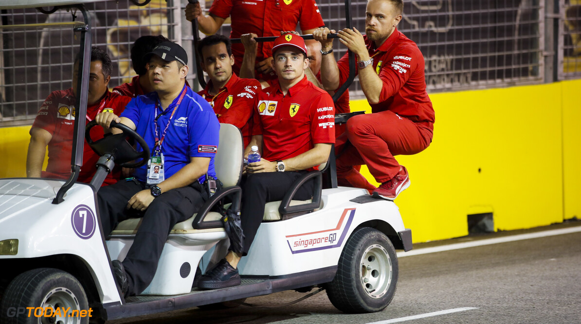 2019 Singapore GP SINGAPORE STREET CIRCUIT, SINGAPORE - SEPTEMBER 19: Charles Leclerc, Ferrari walks the track on a gold buggy during the Singapore GP at Singapore Street Circuit on September 19, 2019 in Singapore Street Circuit, Singapore. (Photo by Joe Portlock / Motorsport Images) 2019 Singapore GP Joe Portlock  Singapore  Portrait