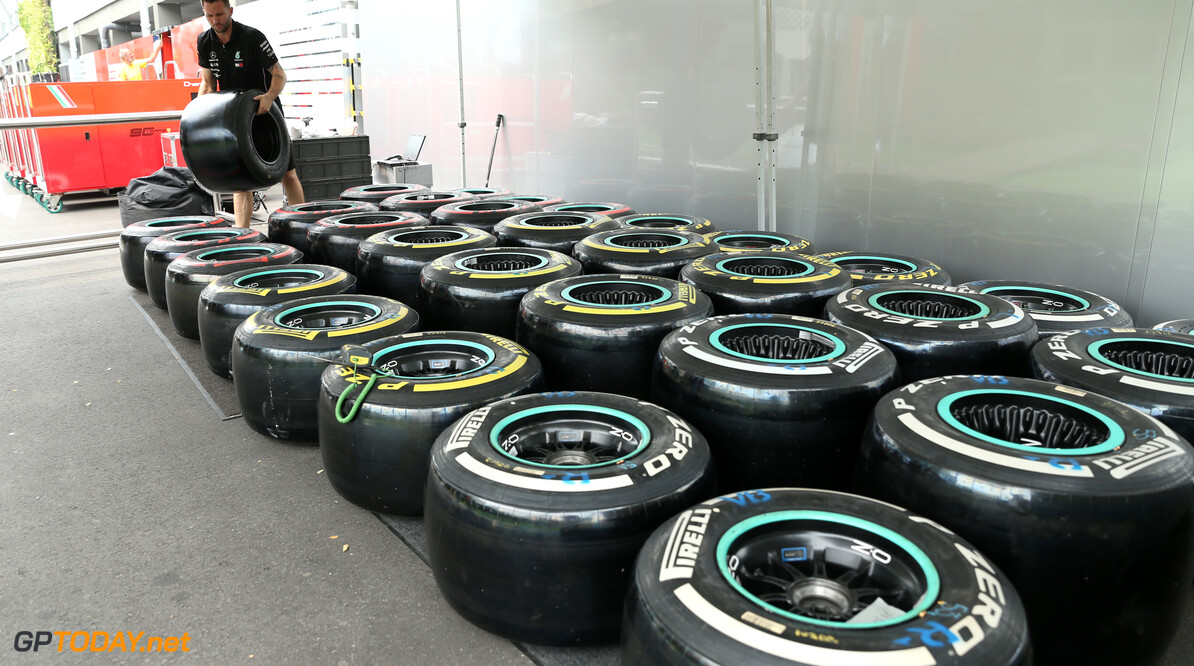 2019 Singapore GP SINGAPORE STREET CIRCUIT, SINGAPORE - SEPTEMBER 18: An AMG Mercedes F1 team member works on Pirelli tyres during the Singapore GP at Singapore Street Circuit on September 18, 2019 in Singapore Street Circuit, Singapore. (Photo by Lionel Ng / Motorsport Images) 2019 Singapore GP Lionel Ng  Singapore  Portrait