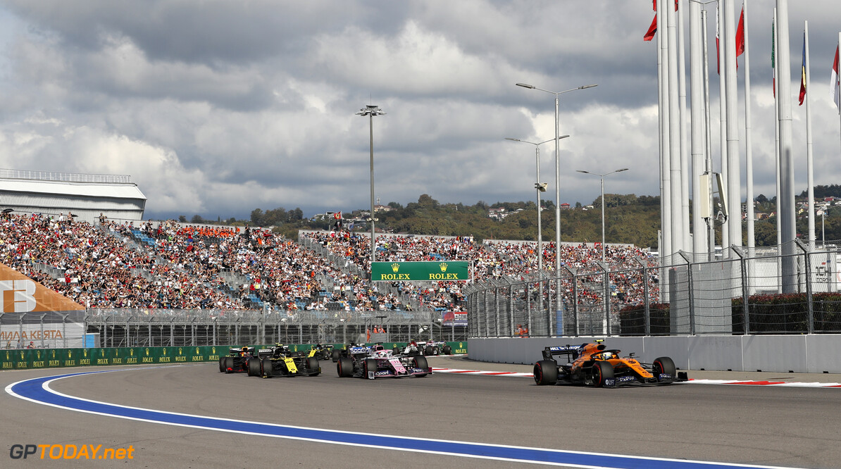 Lando Norris, McLaren MCL34 and Sergio Perez, Racing Point RP19 at the start of the race  Carl Bingham    race GP19016d GP19016d_M F1 GP Russia Russian Sochi