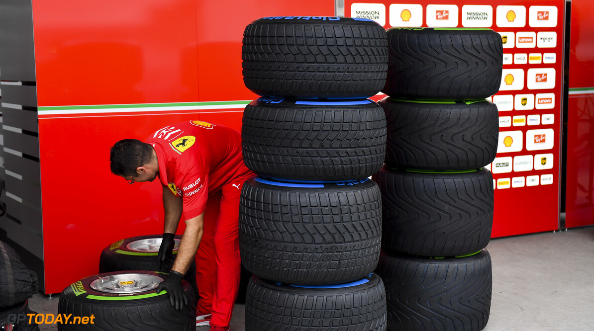 2019 Japanese GP SUZUKA, JAPAN - OCTOBER 11: Ferrari mechanic with Pirelli tyres during the Japanese GP at Suzuka on October 11, 2019 in Suzuka, Japan. (Photo by Simon Galloway / LAT Images) 2019 Japanese GP Simon Galloway  Japan  Portrait ts-live