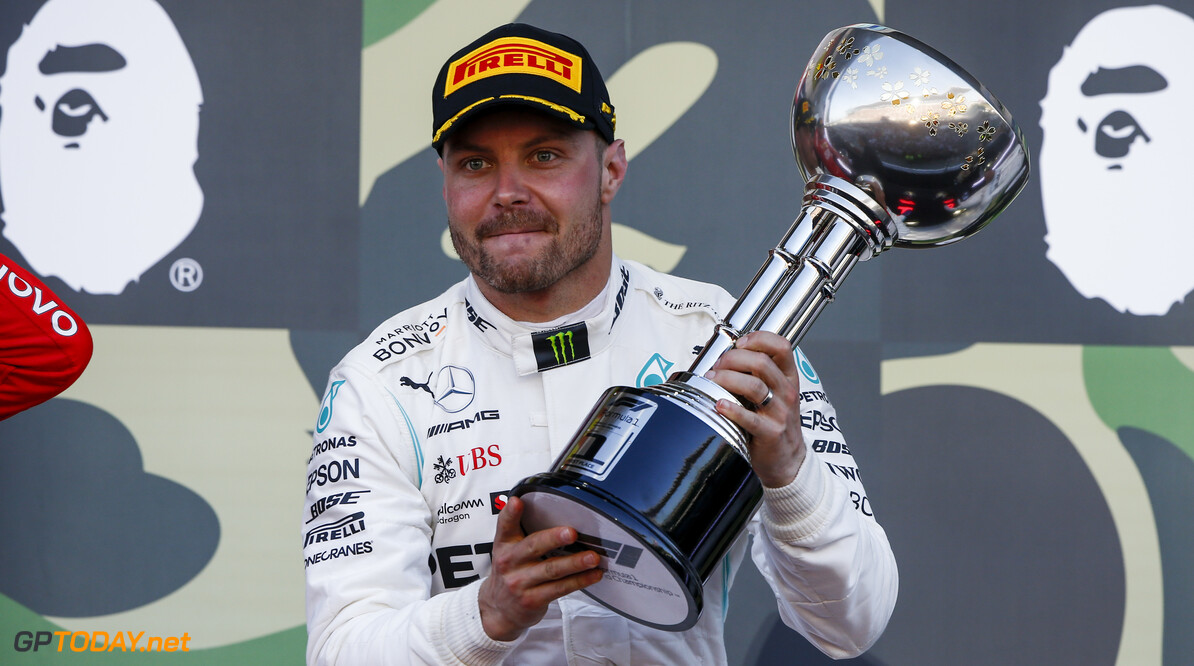 2019 Japanese GP SUZUKA, JAPAN - OCTOBER 13: Race winner Valtteri Bottas, Mercedes AMG F1 celebrates on the podium with the trophy during the Japanese GP at Suzuka on October 13, 2019 in Suzuka, Japan. (Photo by Andy Hone / LAT Images) 2019 Japanese GP Andy Hone  Japan  Portrait ts-live