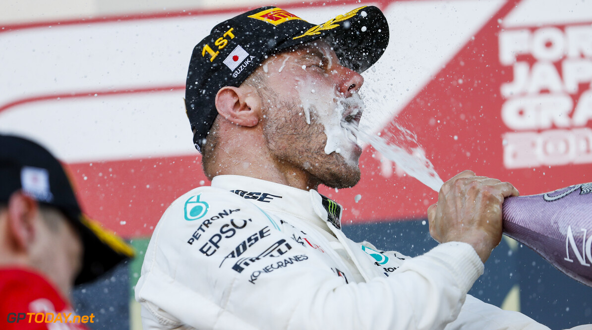 2019 Japanese GP SUZUKA, JAPAN - OCTOBER 13: Race winner Valtteri Bottas, Mercedes AMG F1 celebrates on the podium with the champagne during the Japanese GP at Suzuka on October 13, 2019 in Suzuka, Japan. (Photo by Zak Mauger / LAT Images) 2019 Japanese GP Zak Mauger  Japan  Portrait ts-live