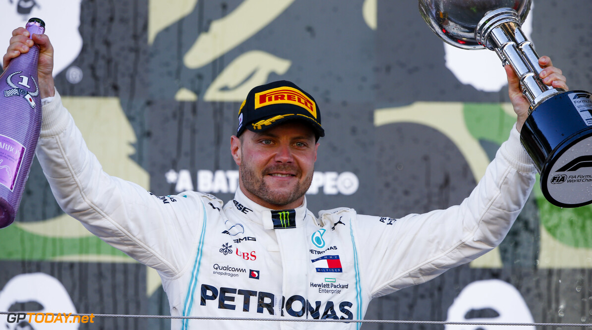 2019 Japanese GP SUZUKA, JAPAN - OCTOBER 13: Race winner Valtteri Bottas, Mercedes AMG F1 celebrates on the podium with the trophy and the champagne during the Japanese GP at Suzuka on October 13, 2019 in Suzuka, Japan. (Photo by Andy Hone / LAT Images) 2019 Japanese GP Andy Hone  Japan  Portrait ts-live