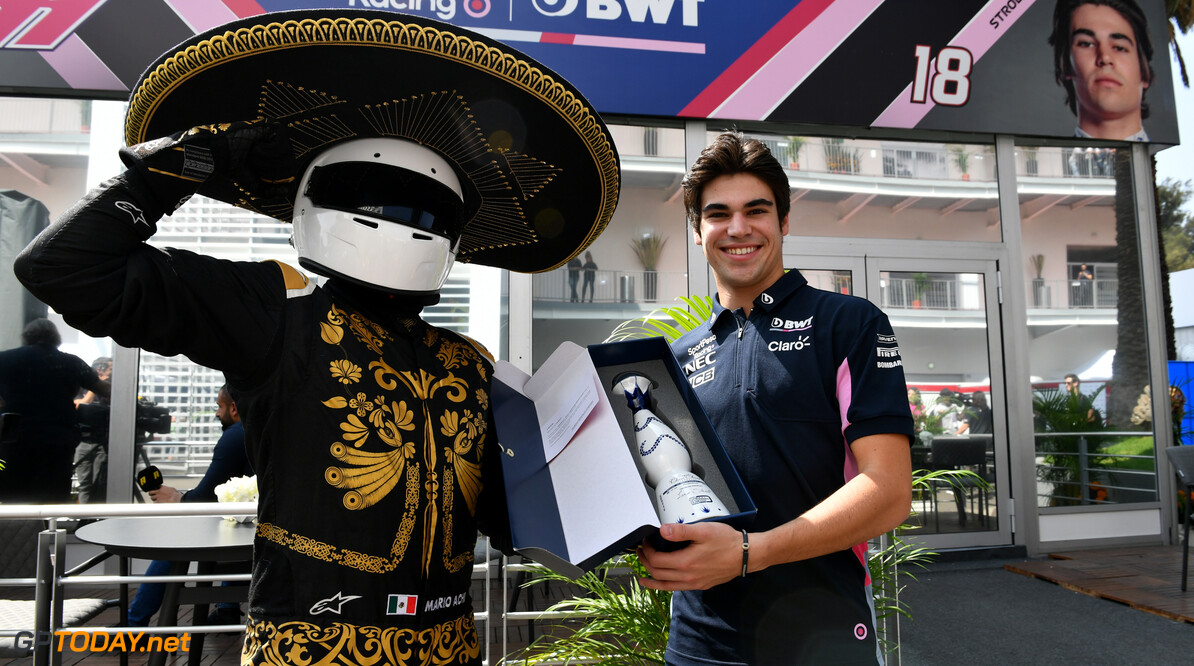 Mario Achi, Mexican GP Promoter presents Sergio Perez, Racing Point with a bottle of tequila  Mark Sutton    media Lance Stroll press conference tequila GP19018a GP19018a_M F1 GP Mexico Mexican Autodromo-Hermanos-Rodriguez