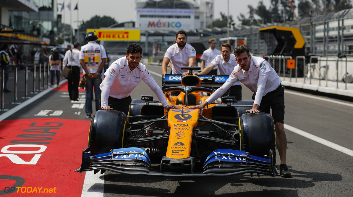 2019 Mexican GP MEXICO CITY - OCTOBER 24: McLaren mechanics push the Carlos Sainz Jr McLaren MCL34 down the pit lane during the 2019 Formula One Mexican Grand Prix at Autodromo Hermanos Rodriguez, on October 24, 2019 in Mexico City, Mexico. (Photo by Steven Tee / LAT Images) 2019 Mexican GP Steven Tee  Mexico  Portrait