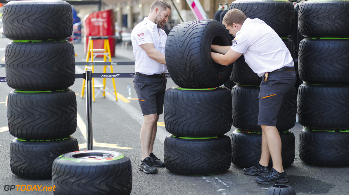 2019 Mexican GP MEXICO CITY - OCTOBER 24: McLaren team members work on Pirelli tyres during the 2019 Formula One Mexican Grand Prix at Autodromo Hermanos Rodriguez, on October 24, 2019 in Mexico City, Mexico. (Photo by Steven Tee / LAT Images) 2019 Mexican GP Steven Tee  Mexico  Portrait
