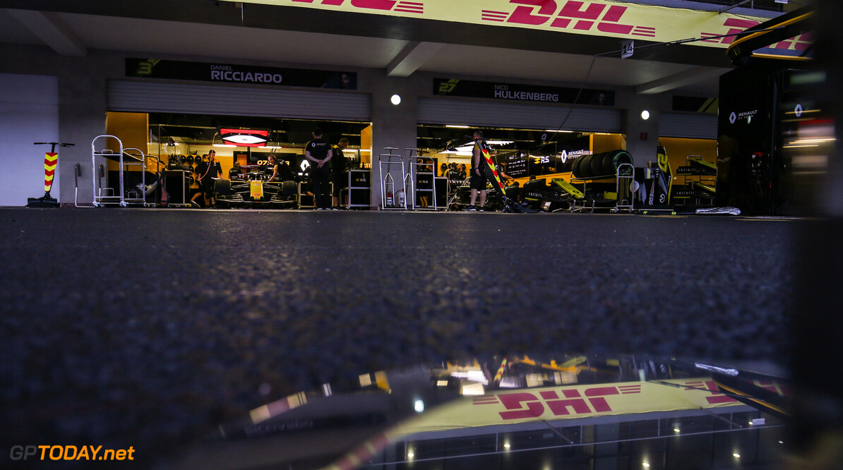 Formula One World Championship Renault F1 Team pit garage at dusk.