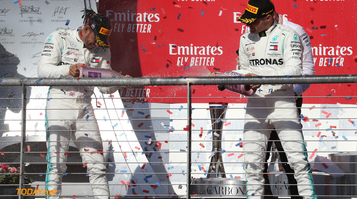 Formula One World Championship 2nd place Lewis Hamilton (GBR) Mercedes AMG F1 W10 and new world champion and 1st place Valtteri Bottas (FIN) Mercedes AMG F1 W10. 03.11.2019. Formula 1 World Championship, Rd 19, United States Grand Prix, Austin, Texas, USA, Race Day. - www.xpbimages.com, EMail: requests@xpbimages.com (C) Copyright: Batchelor / XPB Images Motor Racing - Formula One World Championship - United States Grand Prix - Race Day - Austin, USA XPB Images Austin USA  Formel1 Formel F1 Formula 1 Formula1 GP Grand Prix one Circuit of The Americas November COTA Texas USA United States of America Sunday 03 3 11 2019 Podium Portrait