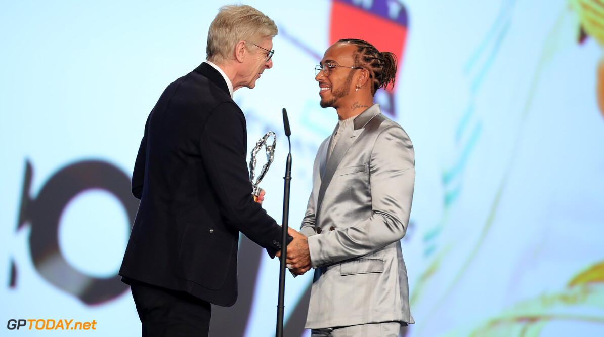 BERLIN, GERMANY - FEBRUARY 17: Arsene Wenger preents the Laureus World Sportsman of the Year award to British F1 driver Lewis Hamilton on stage during the 2020 Laureus World Sports Awards at Verti Music Hall on February 17, 2020 in Berlin, Germany. (Photo by Andreas Rentz/Getty Images for Laureus) Show - 2020 Laureus World Sports Awards - Berlin Andreas Rentz Berlin Germany  Sport Winter Sport Skating Arts Culture and Entertainment Laureus World Sports Awards Awards Ceremony