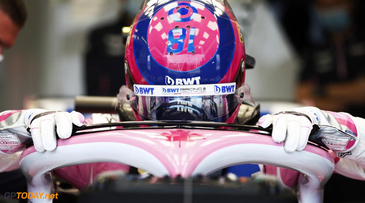 Lance Stroll, Racing Point RP20, climbs in his car in the garage  Glenn Dunbar Silverstone UK  helmet cockpit garage