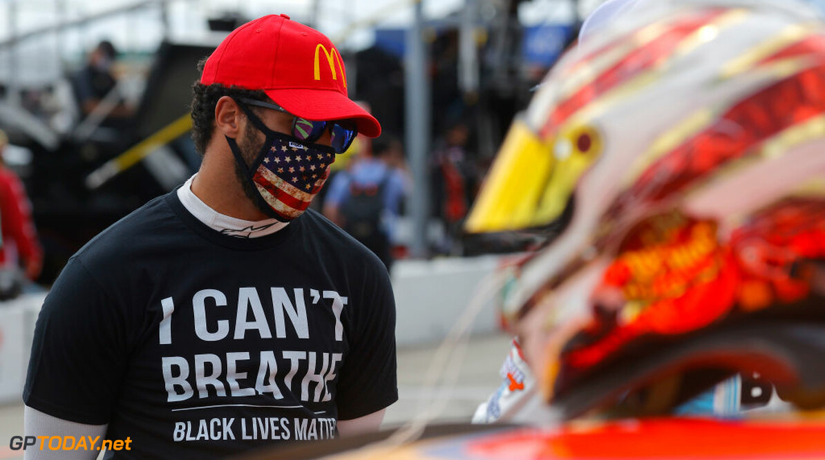 "HAMPTON, GEORGIA - JUNE 07: Bubba Wallace, driver of the #43 McDonald's Chevrolet,  wears  a ""I Can't Breathe - Black Lives Matter"" T-shirt under his fire suit in solidarity with protesters around the world taking to the streets after the death of George Floyd on May 25 while in the custody of Minneapolis, Minnesota police stands on the grid prior to the NASCAR Cup Series Folds of Honor QuikTrip 500 at Atlanta Motor Speedway on June 07, 2020 in Hampton, Georgia. (Photo by Chris Graythen/Getty Images)  Chris Graythen"