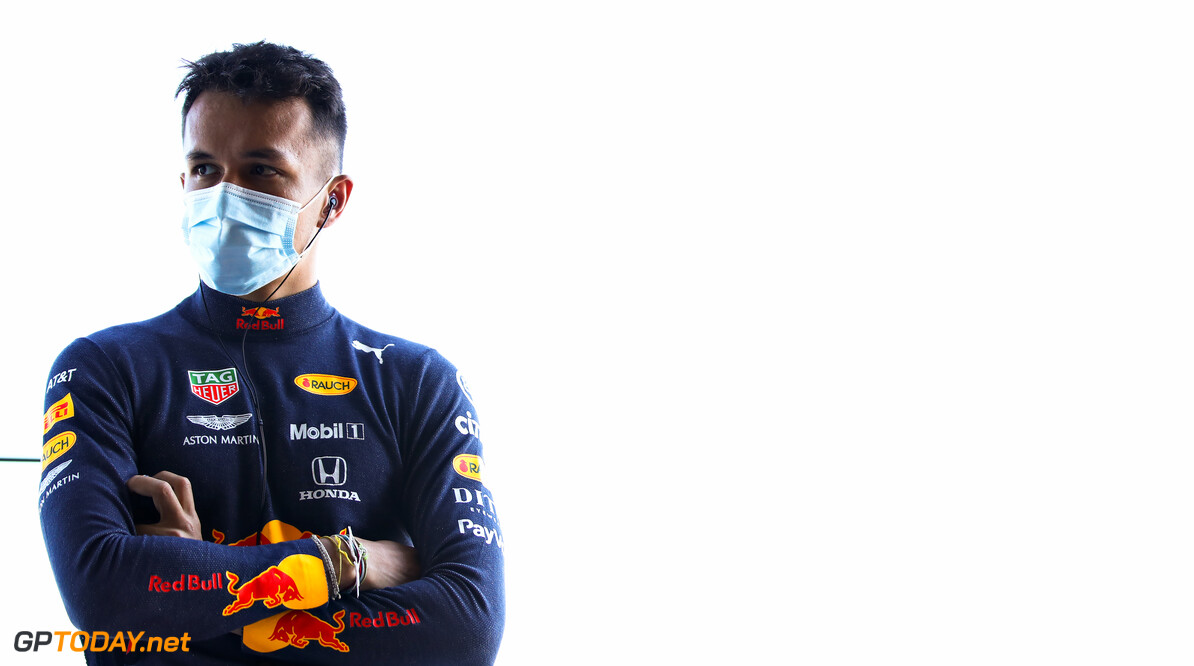 NORTHAMPTON, ENGLAND - JUNE 25: Alexander Albon of Thailand and Red Bull Racing looks on from the garage during the Red Bull Racing RB16 Filming Day at Silverstone Circuit on June 25, 2020 in Northampton, England. (Photo by Mark Thompson/Getty Images) // Getty Images / Red Bull Content Pool  // AP-24EDTMPQ51W11 // Usage for editorial use only //  Red Bull Racing RB16 Filming Day     AP-24EDTMPQ51W11