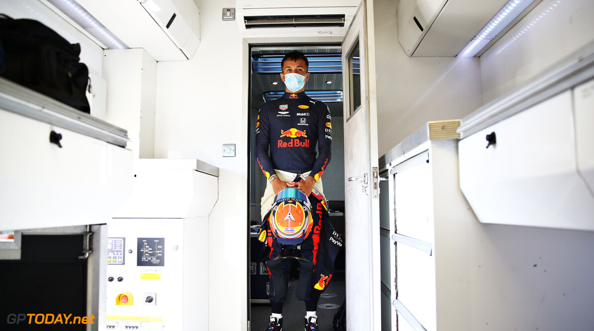NORTHAMPTON, ENGLAND - JUNE 25: Alexander Albon of Thailand and Red Bull Racing walks to the garage during the Red Bull Racing RB16 Filming Day at Silverstone Circuit on June 25, 2020 in Northampton, England. (Photo by Mark Thompson/Getty Images) // Getty Images / Red Bull Content Pool  // AP-24EDTHM1N1W11 // Usage for editorial use only //  Red Bull Racing RB16 Filming Day     AP-24EDTHM1N1W11