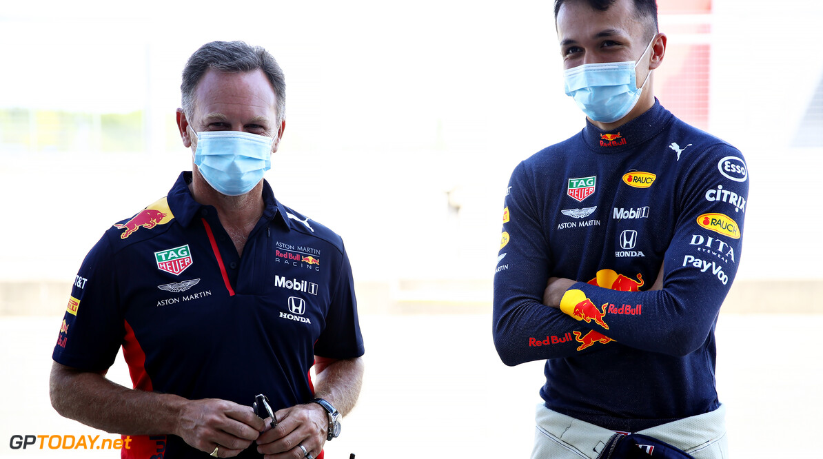 NORTHAMPTON, ENGLAND - JUNE 25: Red Bull Racing Team Principal Christian Horner and Alexander Albon of Thailand and Red Bull Racing talk in the Pitlin the Pitlaneduring the Red Bull Racing RB16 Filming Day at Silverstone Circuit on June 25, 2020 in Northampton, England. (Photo by Mark Thompson/Getty Images) // Getty Images / Red Bull Content Pool  // AP-24EECW17N2111 // Usage for editorial use only //  Red Bull Racing RB16 Filming Day     AP-24EECW17N2111