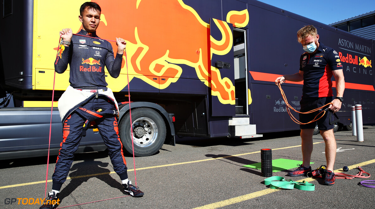NORTHAMPTON, ENGLAND - JUNE 25: Alexander Albon of Thailand and Red Bull Racing warms up before driving during the Red Bull Racing RB16 Filming Day at Silverstone Circuit on June 25, 2020 in Northampton, England. (Photo by Mark Thompson/Getty Images) // Getty Images / Red Bull Content Pool  // AP-24EECKC351W11 // Usage for editorial use only //  Red Bull Racing RB16 Filming Day     AP-24EECKC351W11