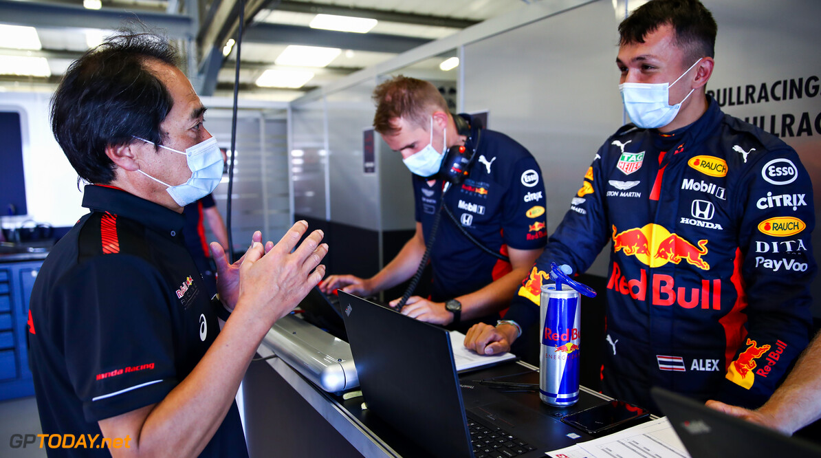 NORTHAMPTON, ENGLAND - JUNE 25: Alexander Albon of Thailand and Red Bull Racing talks with Toyoharu Tanabe of Honda in the garage during the Red Bull Racing RB16 Filming Day at Silverstone Circuit on June 25, 2020 in Northampton, England. (Photo by Mark Thompson/Getty Images) // Getty Images / Red Bull Content Pool  // AP-24EF2AD211W11 // Usage for editorial use only //  Red Bull Racing RB16 Filming Day     AP-24EF2AD211W11