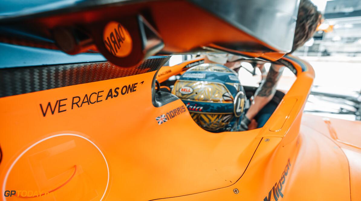 We Race As One logo on the car of Lando Norris, McLaren MCL35   Spielberg Austria  Portrait Helmets
