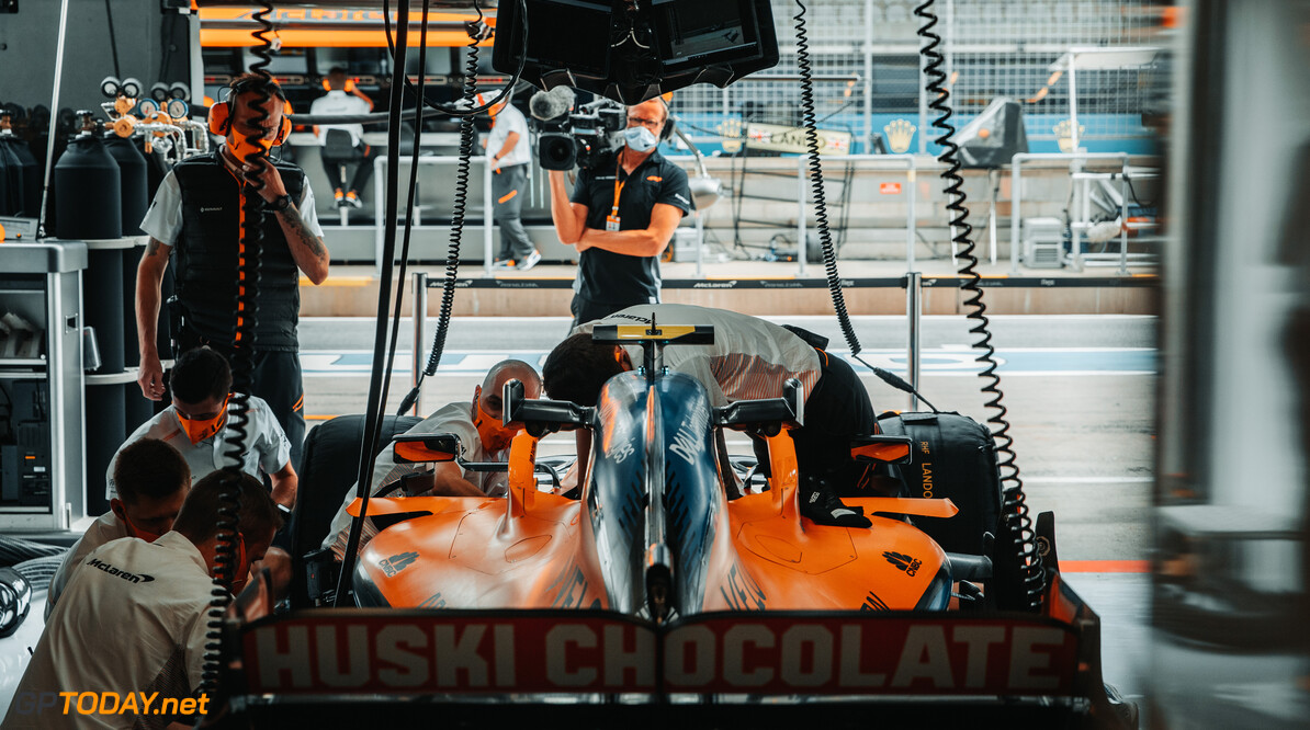 Mechanics at work on the car of Lando Norris, McLaren MCL35, in the garage   Spielberg Austria  Portrait Technical Garages