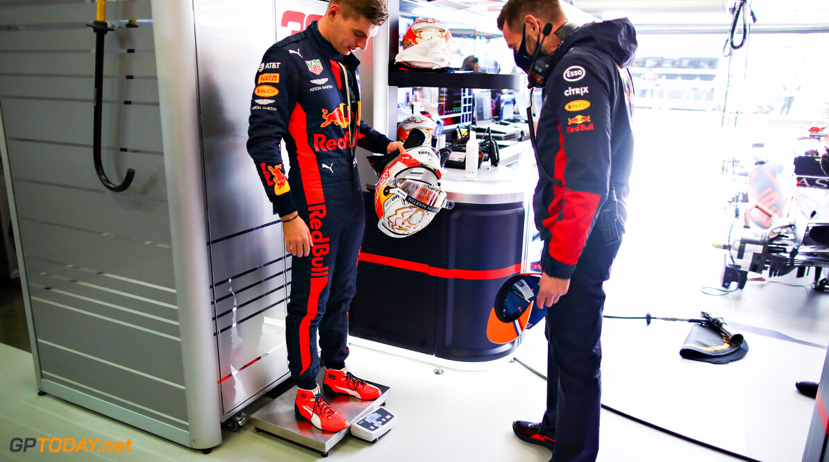 NUERBURG, GERMANY - OCTOBER 10: Max Verstappen of Netherlands and Red Bull Racing is weighed in the garage before final practice ahead of the F1 Eifel Grand Prix at Nuerburgring on October 10, 2020 in Nuerburg, Germany. (Photo by Mark Thompson/Getty Images) // Getty Images / Red Bull Content Pool  // SI202010100022 // Usage for editorial use only //  F1 Eifel Grand Prix - Final Practice     SI202010100022