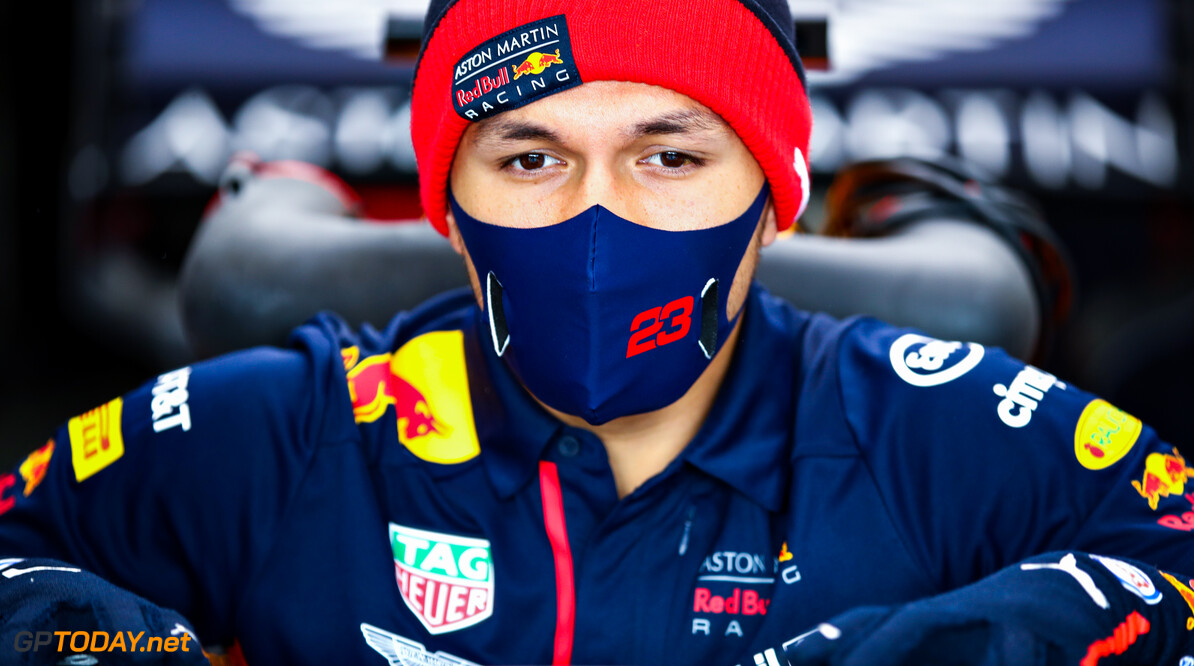 NUERBURG, GERMANY - OCTOBER 11: Alexander Albon of Thailand and Red Bull Racing climbs into his car in the garage before the F1 Eifel Grand Prix at Nuerburgring on October 11, 2020 in Nuerburg, Germany. (Photo by Mark Thompson/Getty Images) // Getty Images / Red Bull Content Pool  // SI202010110111 // Usage for editorial use only //  F1 Eifel Grand Prix     SI202010110111