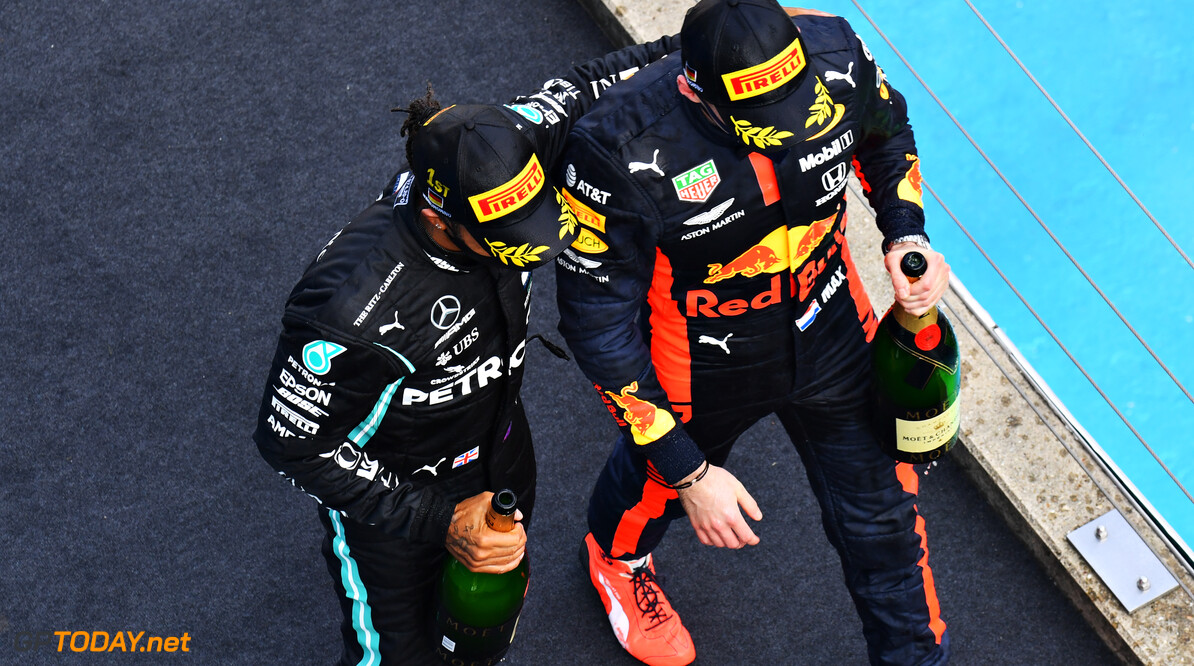 NUERBURG, GERMANY - OCTOBER 11: Race winner Lewis Hamilton of Great Britain and Mercedes GP and second placed Max Verstappen of Netherlands and Red Bull Racing celebrate on the podium during the F1 Eifel Grand Prix at Nuerburgring on October 11, 2020 in Nuerburg, Germany. (Photo by Getty Images/Getty Images) // Getty Images / Red Bull Content Pool  // SI202010110537 // Usage for editorial use only //  F1 Eifel Grand Prix     SI202010110537
