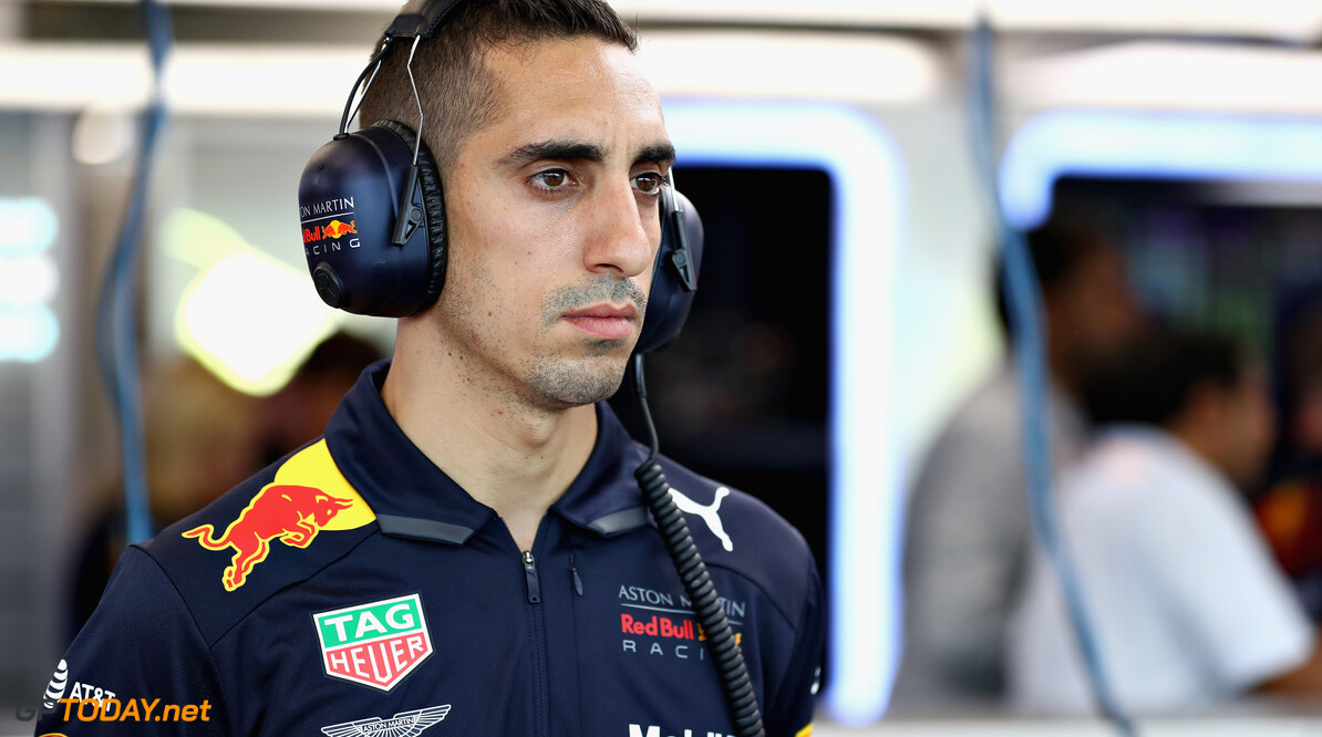 SINGAPORE - SEPTEMBER 14:  Sebastien Buemi of Switzerland and Red Bull Racing looks on in the garage during practice for the Formula One Grand Prix of Singapore at Marina Bay Street Circuit on September 14, 2018 in Singapore.  (Photo by Mark Thompson/Getty Images) // Getty Images / Red Bull Content Pool  // SI201809140556 // Usage for editorial use only //  F1 Grand Prix of Singapore - Practice     SI201809140556