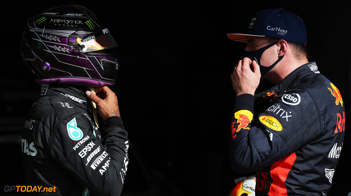 PORTIMAO, PORTUGAL - OCTOBER 24: Pole position qualifier Lewis Hamilton of Great Britain and Mercedes GP speaks with third placed Max Verstappen of Netherlands and Red Bull Racing in parc ferme during qualifying ahead of the F1 Grand Prix of Portugal at Autodromo Internacional do Algarve on October 24, 2020 in Portimao, Portugal. (Photo by Jose Sena Goulao - Pool/Getty Images) // Getty Images / Red Bull Content Pool  // SI202010240294 // Usage for editorial use only //  F1 Grand Prix of Portugal - Qualifying     SI202010240294