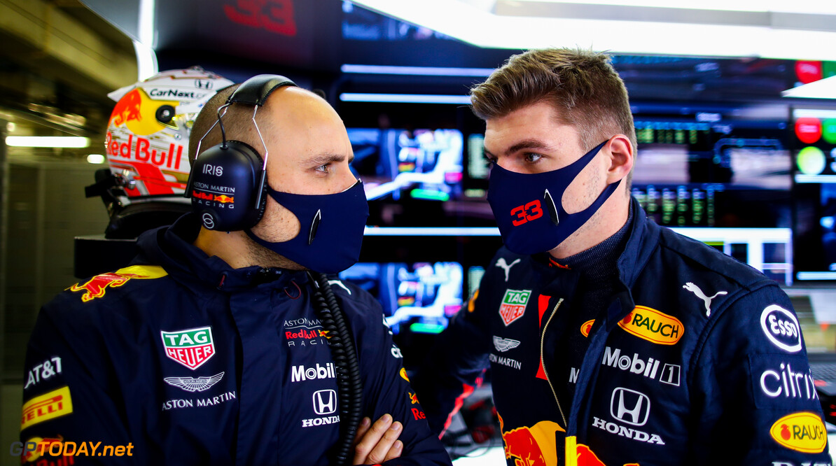 PORTIMAO, PORTUGAL - OCTOBER 24: Max Verstappen of Netherlands and Red Bull Racing talks with race engineer Gianpiero Lambiase in the garage during qualifying ahead of the F1 Grand Prix of Portugal at Autodromo Internacional do Algarve on October 24, 2020 in Portimao, Portugal. (Photo by Mark Thompson/Getty Images) // Getty Images / Red Bull Content Pool  // SI202010240265 // Usage for editorial use only //  F1 Grand Prix of Portugal - Qualifying     SI202010240265