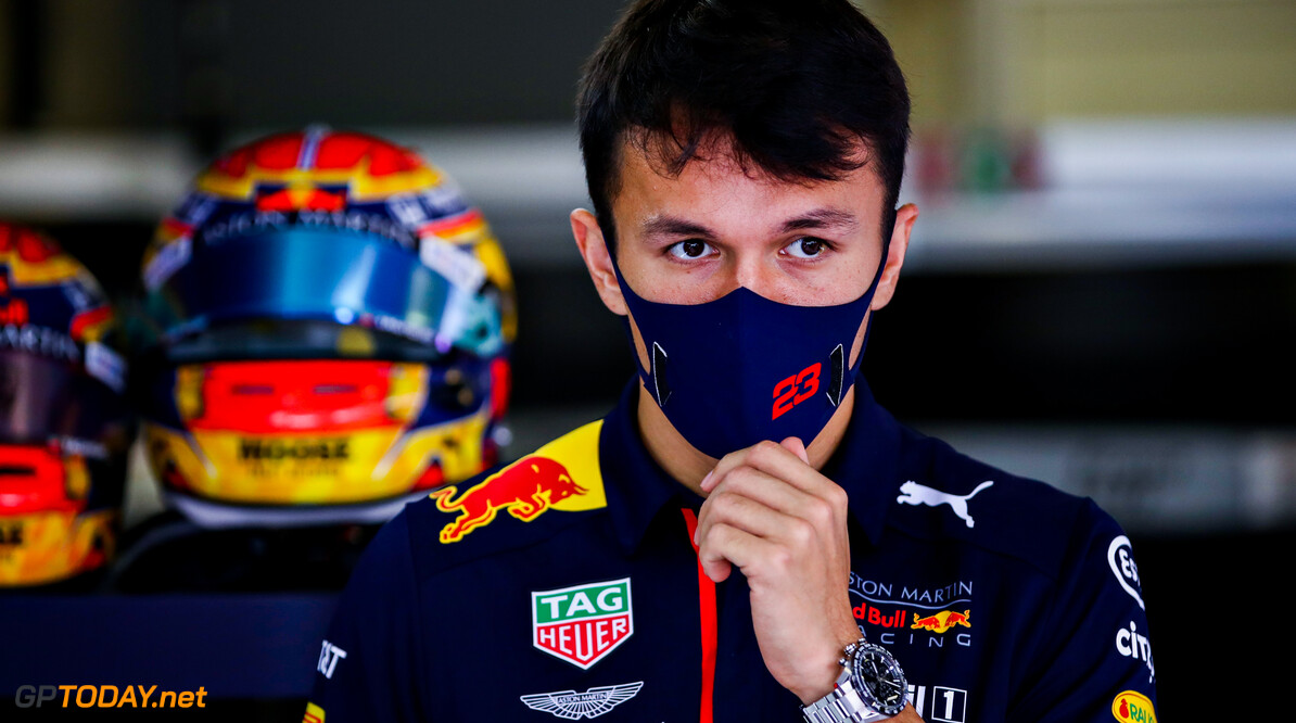 PORTIMAO, PORTUGAL - OCTOBER 25: Alexander Albon of Thailand and Red Bull Racing looks on in the garage before the F1 Grand Prix of Portugal at Autodromo Internacional do Algarve on October 25, 2020 in Portimao, Portugal. (Photo by Mark Thompson/Getty Images) // Getty Images / Red Bull Content Pool  // SI202010250047 // Usage for editorial use only //  F1 Grand Prix of Portugal     SI202010250047