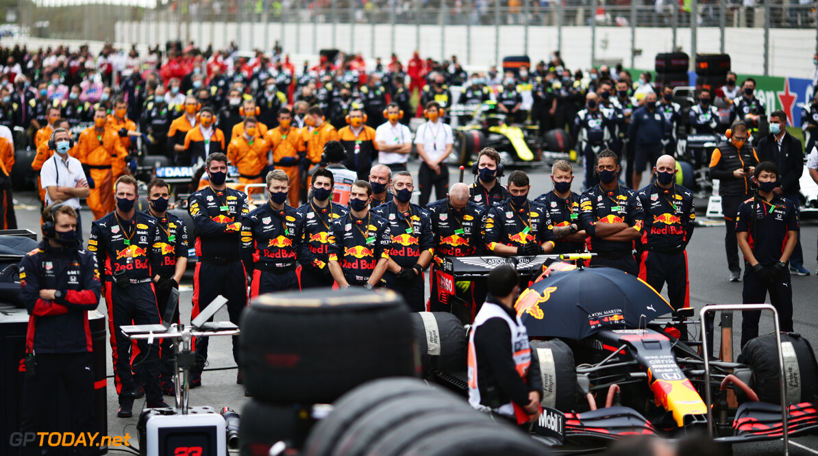 PORTIMAO, PORTUGAL - OCTOBER 25: The Red Bull Racing team stand for the national anthem on the grid before the F1 Grand Prix of Portugal at Autodromo Internacional do Algarve on October 25, 2020 in Portimao, Portugal. (Photo by Peter Fox/Getty Images) // Getty Images / Red Bull Content Pool  // SI202010250131 // Usage for editorial use only //  F1 Grand Prix of Portugal     SI202010250131