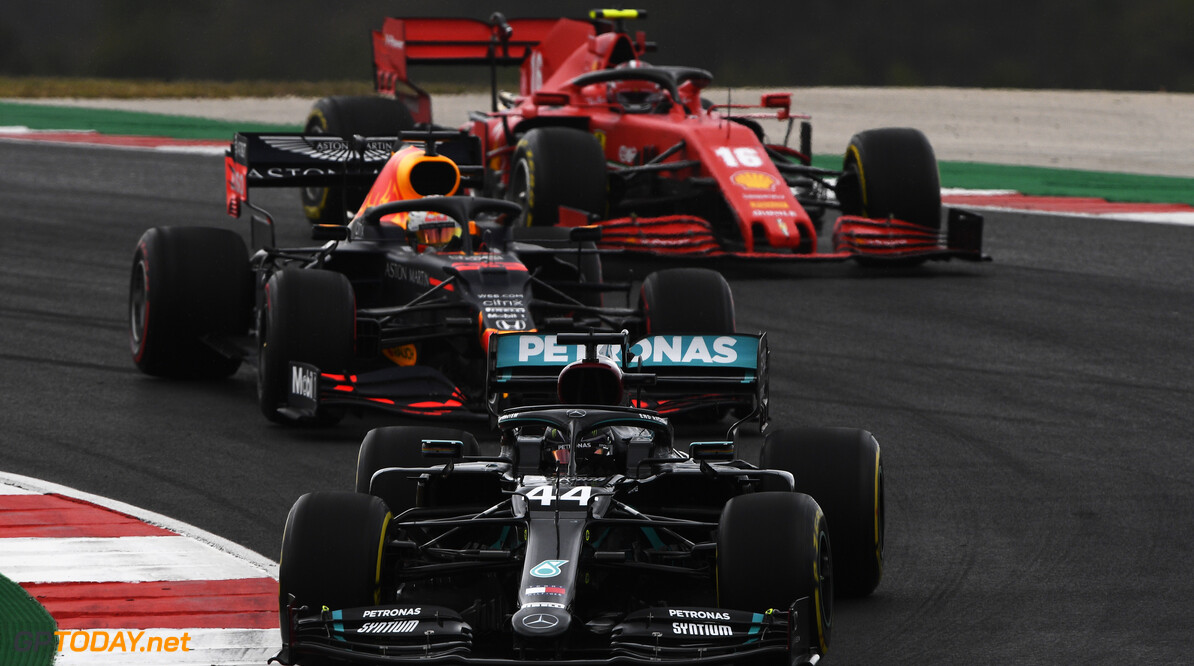 PORTIMAO, PORTUGAL - OCTOBER 25: Lewis Hamilton of Great Britain driving the (44) Mercedes AMG Petronas F1 Team Mercedes W11 leads Max Verstappen of the Netherlands driving the (33) Aston Martin Red Bull Racing RB16 and Charles Leclerc of Monaco driving the (16) Scuderia Ferrari SF1000  during the F1 Grand Prix of Portugal at Autodromo Internacional do Algarve on October 25, 2020 in Portimao, Portugal. (Photo by Rudy Carezzevoli/Getty Images) // Getty Images / Red Bull Content Pool  // SI202010250145 // Usage for editorial use only //  F1 Grand Prix of Portugal     SI202010250145