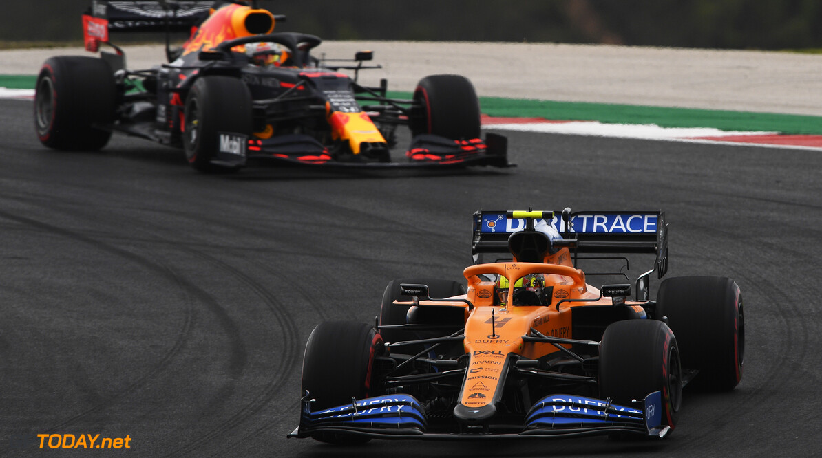 PORTIMAO, PORTUGAL - OCTOBER 25: Lando Norris of Great Britain driving the (4) McLaren F1 Team MCL35 Renault leads Max Verstappen of the Netherlands driving the (33) Aston Martin Red Bull Racing RB16on track  during the F1 Grand Prix of Portugal at Autodromo Internacional do Algarve on October 25, 2020 in Portimao, Portugal. (Photo by Rudy Carezzevoli/Getty Images) // Getty Images / Red Bull Content Pool  // SI202010250172 // Usage for editorial use only //  F1 Grand Prix of Portugal     SI202010250172