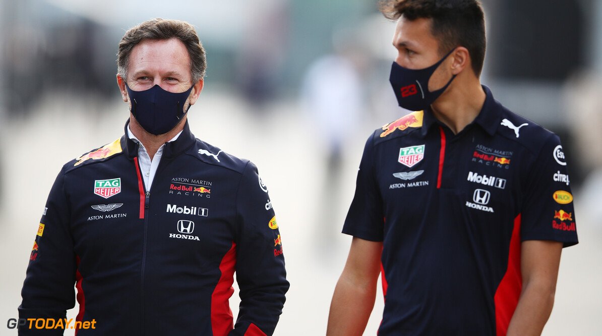 IMOLA, ITALY - OCTOBER 30: Red Bull Racing Team Principal Christian Horner and Alexander Albon of Thailand and Red Bull Racing walk in the Paddock during previews ahead of the F1 Grand Prix of Emilia Romagna at Autodromo Enzo e Dino Ferrari on October 30, 2020 in Imola, Italy. (Photo by Mark Thompson/Getty Images) // Getty Images / Red Bull Content Pool  // SI202010300586 // Usage for editorial use only //  F1 Grand Prix of Emilia Romagna - Previews     SI202010300586