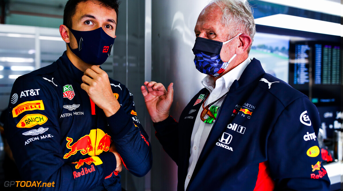IMOLA, ITALY - OCTOBER 31: Alexander Albon of Thailand and Red Bull Racing talks with Red Bull Racing Team Consultant Dr Helmut Marko in the garage during practice ahead of the F1 Grand Prix of Emilia Romagna at Autodromo Enzo e Dino Ferrari on October 31, 2020 in Imola, Italy. (Photo by Mark Thompson/Getty Images) // Getty Images / Red Bull Content Pool  // SI202010310285 // Usage for editorial use only //  F1 Grand Prix of Emilia Romagna - Practice & Qualifying     SI202010310285