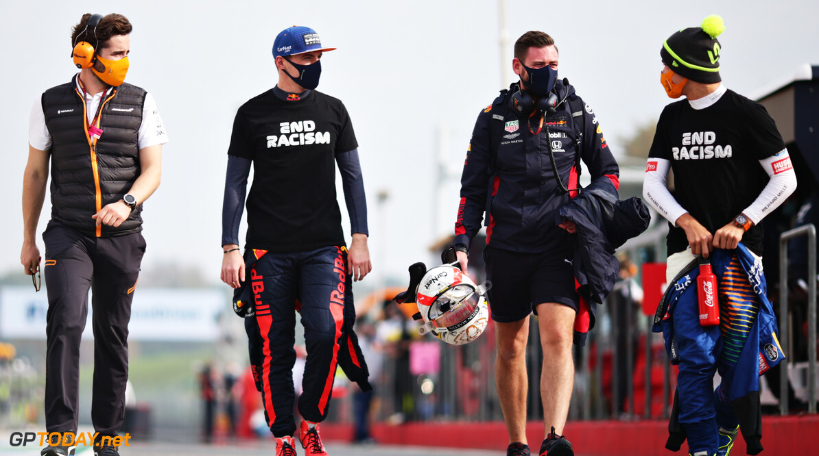 IMOLA, ITALY - NOVEMBER 01: Max Verstappen of Netherlands and Red Bull Racing and Lando Norris of Great Britain and McLaren F1 talk on their way to the grid before the F1 Grand Prix of Emilia Romagna at Autodromo Enzo e Dino Ferrari on November 01, 2020 in Imola, Italy. (Photo by Peter Fox/Getty Images) // Getty Images / Red Bull Content Pool  // SI202011010095 // Usage for editorial use only //  F1 Grand Prix of Emilia Romagna     SI202011010095