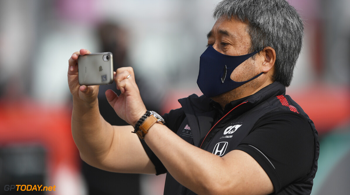 IMOLA, ITALY - NOVEMBER 01: Masashi Yamamoto of Honda uses his phone on the grid prior to the F1 Grand Prix of Emilia Romagna at Autodromo Enzo e Dino Ferrari on November 01, 2020 in Imola, Italy. Red Bull Racing, Scuderia AlphaTauri (Photo by Rudy Carezzevoli/Getty Images) // Getty Images / Red Bull Content Pool  // SI202011010084 // Usage for editorial use only //  F1 Grand Prix of Emilia Romagna     SI202011010084